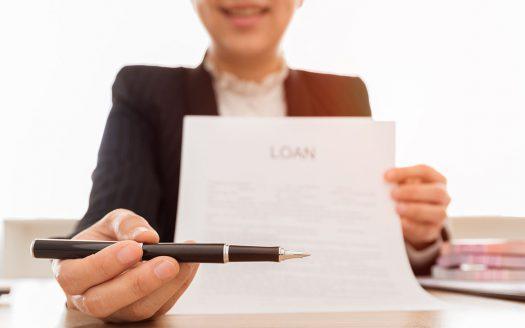 Boyd Real Estate lender-handing-pen